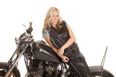Woman leather lay side motorcycle royalty free stock images