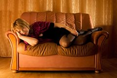Woman On Leather Loveseat Royalty Free Stock Image