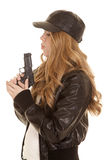 Woman leather pistol blow side Royalty Free Stock Image