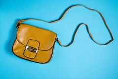 Woman leather purse on blue background. Woman leather purse isolated on blue background Stock Image