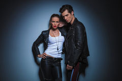 Woman in leather resting her hand on boyfriend's shoulder Stock Photos