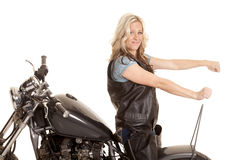 Woman leather ride motorcycle backwards royalty free stock images