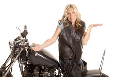 Woman leather sit motorcycle backwards shrug royalty free stock image