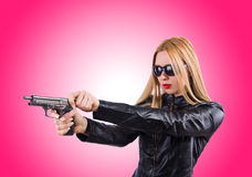 Woman in leather suit with handgun Royalty Free Stock Photos