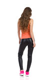 Woman In Leather Trousers Standing Back Stock Photo