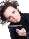 Woman in leather wear holding gun over white Stock Photography