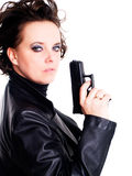 Woman in leather wear holding gun over white stock photo