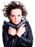 Woman in leather wear holding gun over white Royalty Free Stock Photo