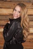 Woman leather wood background back smile Royalty Free Stock Image
