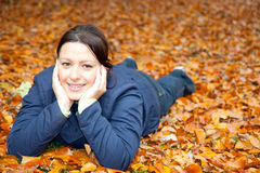 Woman on leaves Royalty Free Stock Images