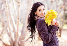 Woman with leaves Stock Photos