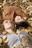 Woman in leaves eyes closed Stock Photography