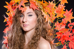 Woman with leaves in nature concept Stock Photos