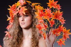 The woman with leaves in nature concept Stock Photos