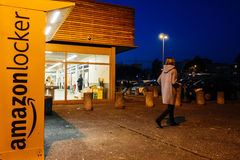 Woman leaving Amazon Locker delivery prcel Royalty Free Stock Photo