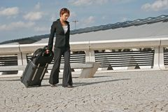 Woman leaving on a journey. Woman leaving travels from there with her luggage Royalty Free Stock Photography