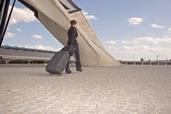 Woman leaving on a journey. Woman travels with her luggage Stock Image