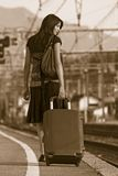 Woman leaving on a journey. Woman leaving travels from there with her luggage Royalty Free Stock Photos