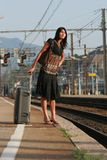 Woman leaving on a journey. Woman leaving travels from there with her luggage Royalty Free Stock Photo