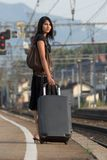 Woman leaving on a journey. Woman leaving travels from there with her luggage Stock Photos