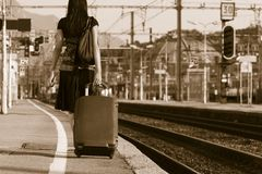 Woman leaving on a journey. Woman leaving travels from there with her luggage Stock Image