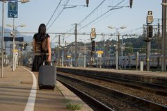 Woman leaving on a journey. Woman leaving travels from there with her luggage Royalty Free Stock Images