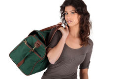 Woman leaving with packed bag Stock Images