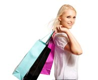 Woman Leaving the Store with Her Purchases Stock Images