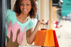 Woman leaving store Stock Image