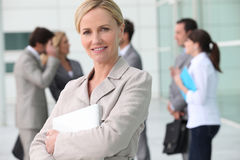 Woman leaving work Stock Image