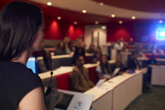 Free Woman Lecturing Students In Lecture Theatre, Focus Foreground Royalty Free Stock Photography - 79848647
