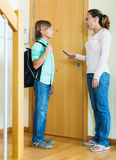 Woman lecturing teenager boy before he goes to school Royalty Free Stock Photo