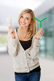 Woman with led light bulb and windmill Stock Image