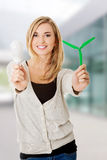 Woman with led light bulb and windmill Stock Photography