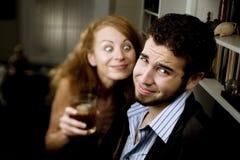 Woman Leers at Man at Party. Woman pursuing a man at a party makes him uncomfortable Royalty Free Stock Photography