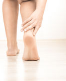 Woman leg with ankle pain Stock Photography