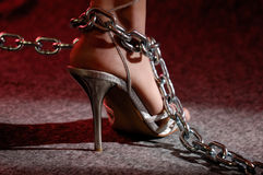 Woman leg in chains. Sexy woman legs in high heel shoes in chains Royalty Free Stock Images