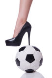 Woman leg with football isolated on white Royalty Free Stock Photography
