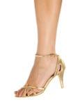 Woman leg in golden shoe Stock Photo