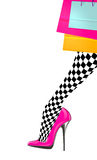 Woman leg with pink high heel shoe, chess stocking and shopping bags Royalty Free Stock Image