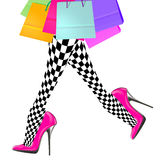 Woman leg with pink high heel shoes, shopping bags Royalty Free Stock Photos