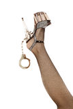 Woman leg with shoe and handcuffs Royalty Free Stock Photography