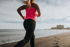 Woman leg stretching at the beach. royalty free stock photography