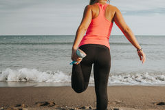Woman leg stretching at the beach. royalty free stock photo