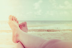 Woman leg on tropical sea beach - Filtered image processed vinta Stock Photos