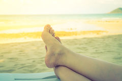 Woman leg on tropical sea beach - Filtered image processed vinta Stock Images
