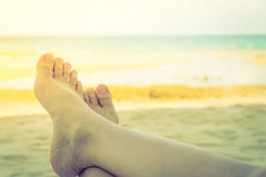 Woman leg on tropical sea beach - Filtered image processed vinta Stock Photography