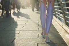 Woman in leggings walking on bridge Royalty Free Stock Photos