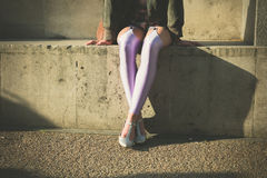 Woman in leggins sitting outside Royalty Free Stock Images