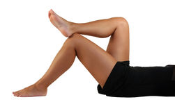 Woman legs. Isolated over white background Stock Image